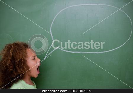 Schoolgirl screaming a speech bubble stock photo, Schoolgirl screaming a speech bubble in front of a blackboard by Wavebreak Media