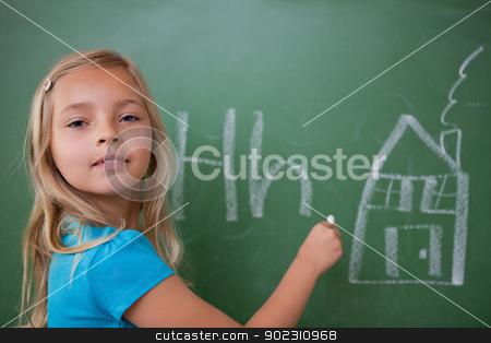 Schoolgirl learning the alphabet stock photo, Schoolgirl learning the alphabet on a blackboard by Wavebreak Media