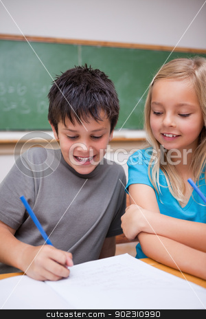 Portrait of happy pupils working together stock photo, Portrait of happy pupils working together in a classroom by Wavebreak Media