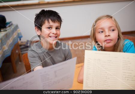 Pupils receiving their school report stock photo, Pupils receiving their school report in a classroom by Wavebreak Media