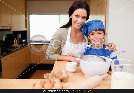 Mother and son preparing cake stock photo, Mother and son preparing cake together by Wavebreak Media