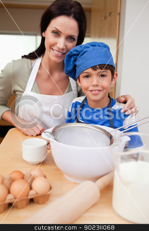 Son and mother preparing cake stock photo, Son and mother preparing cake together by Wavebreak Media