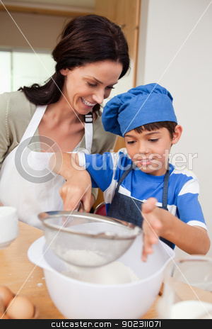 Mother and son baking stock photo, Mother and son baking together by Wavebreak Media