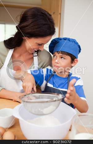 Son and mother baking stock photo, Son and mother baking together by Wavebreak Media