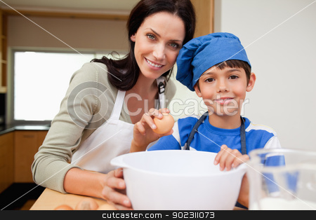 Mother and son baking cake stock photo, Mother and son baking cake together by Wavebreak Media