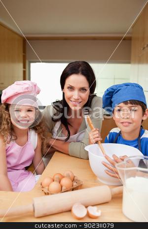 Mother and her children preparing dough stock photo, Mother and her children preparing dough together by Wavebreak Media