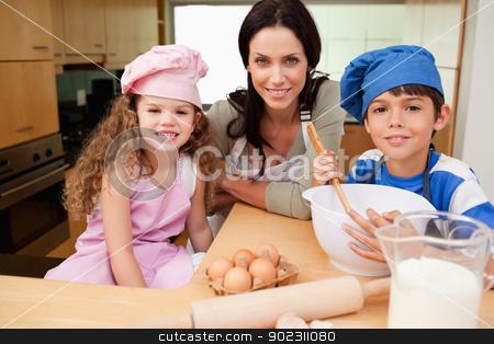 Mother and her children preparing cookies stock photo, Mother and her children preparing cookies together by Wavebreak Media