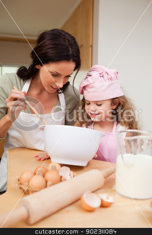 Mother and daughter preparing cookies stock photo, Mother and daughter preparing cookies together by Wavebreak Media