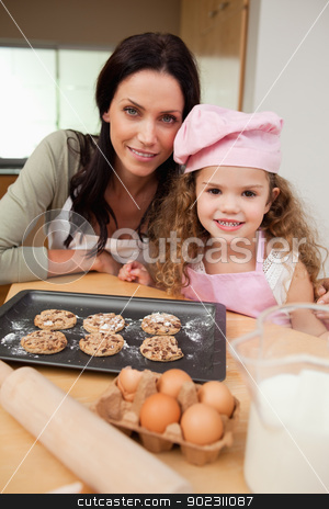 Mother and daughter with cookies stock photo, Mother and daughter together with cookies by Wavebreak Media