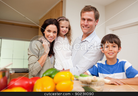 Family standing in the kitchen stock photo, Family standing in the kitchen together by Wavebreak Media