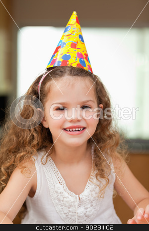 Girl with party hat stock photo, Smiling girl with party hat by Wavebreak Media
