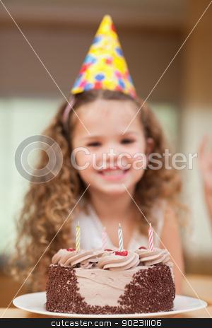 Slice of cake in front of girl stock photo, Slice of cake in front of little girl by Wavebreak Media