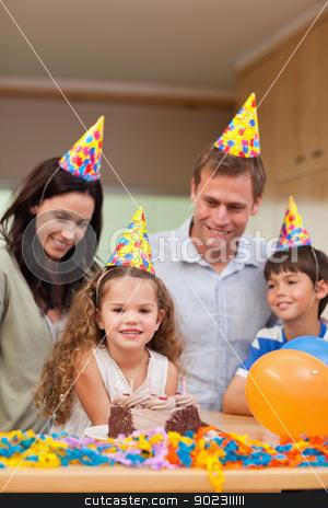 Family celebrating daughters birthday stock photo, Family celebrating daughters birthday together by Wavebreak Media