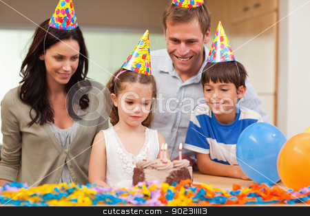 Girl about to blow out the candles on her birthday cake stock photo, Young girl about to blow out the candles on her birthday cake by Wavebreak Media