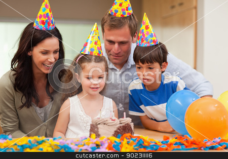 Girl blew out the candles on her birthday cake stock photo, Little girl blew out the candles on her birthday cake by Wavebreak Media