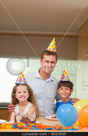 Father celebrating with his kids stock photo, Smiling father celebrating with his kids by Wavebreak Media