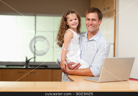 Father carrying his daughter on his arms stock photo, Father carrying his little daughter on his arm by Wavebreak Media