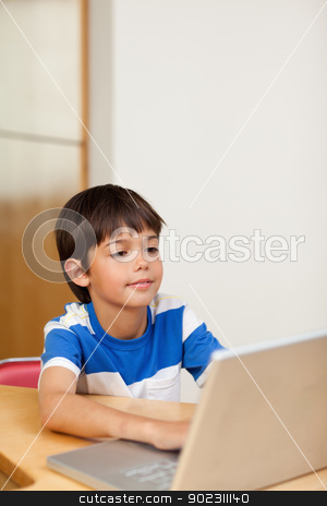 Boy playing computer games on the laptop stock photo, Little boy playing computer games on the laptop by Wavebreak Media
