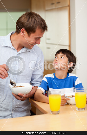 Father and son having healthy breakfast stock photo, Father and son having healthy breakfast together by Wavebreak Media