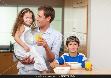 Father having breakfast with his kids stock photo, Father having breakfast together with his kids by Wavebreak Media