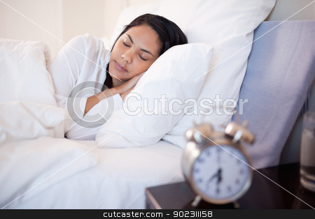 Side view of woman sleeping stock photo, Side view of young woman sleeping by Wavebreak Media