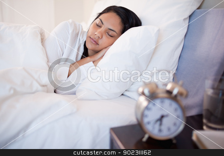 Side view of sleeping woman stock photo, Side view of sleeping young woman by Wavebreak Media