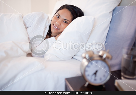 Side view of woman that just woke up stock photo, Side view of young woman that just woke up by Wavebreak Media