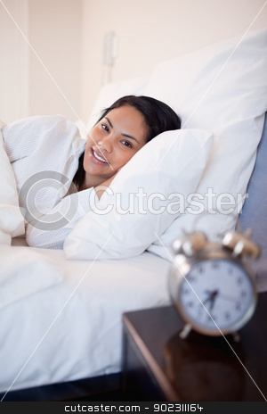 Side view of woman lying in the bed stock photo, Side view of young woman lying in the bed by Wavebreak Media
