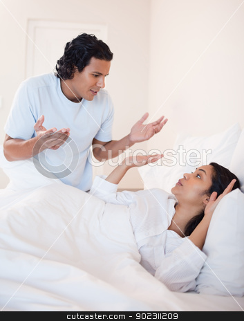 Couple fighting in the bedroom stock photo, Young couple fighting in the bedroom by Wavebreak Media