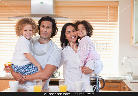 Family having breakfast in the kitchen together stock photo, Young family having breakfast in the kitchen together by Wavebreak Media