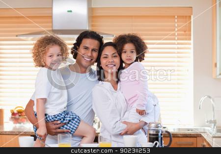 Family having breakfast in the kitchen stock photo, Young family having breakfast in the kitchen by Wavebreak Media