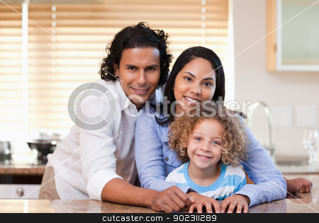 Family together in the kitchen stock photo, Young family together in the kitchen by Wavebreak Media