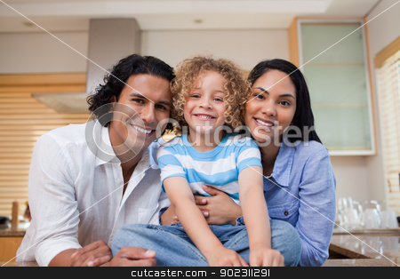 Cheerful family together in the kitchen stock photo, Cheerful young family together in the kitchen by Wavebreak Media