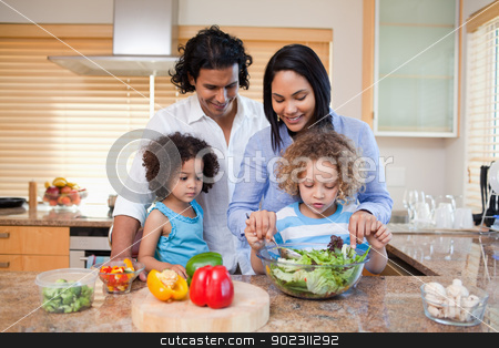 Family preparing salad together in the kitchen stock photo, Young family preparing salad together in the kitchen by Wavebreak Media