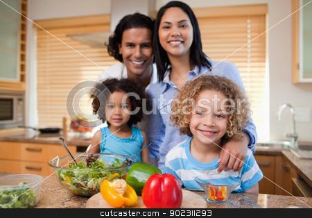 Family preparing salad together stock photo, Young family preparing salad together by Wavebreak Media