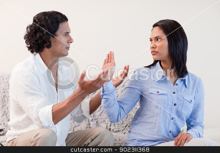 Male begging his girlfriend for pardon stock photo, Young male begging his girlfriend for pardon by Wavebreak Media