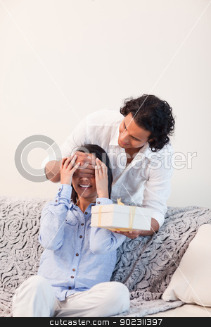 Man having a surprise for his girlfriend stock photo, Young man having a surprise for his girlfriend by Wavebreak Media