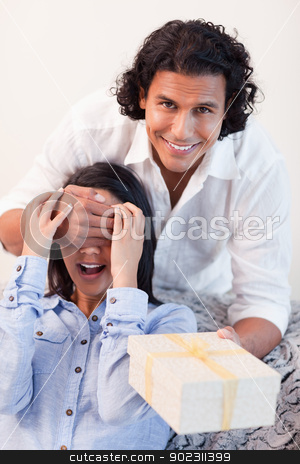 Male having a surprise for his girlfriend stock photo, Young male having a surprise for his girlfriend by Wavebreak Media