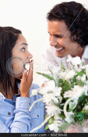Woman is surprised by the bouquet she got from her boyfriend stock photo, Young woman is surprised by the bouquet she got from her boyfriend by Wavebreak Media