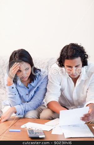 Couple having financial problems stock photo, Young couple having financial problems by Wavebreak Media