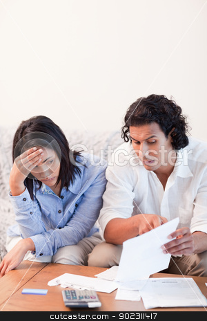 Couple talking about bad news they got by mail stock photo, Young couple talking about bad news they got by mail by Wavebreak Media