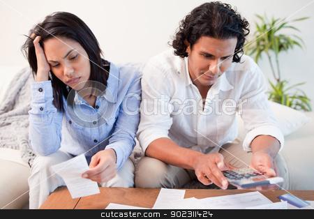 Couple having a hard time doing their finances stock photo, Young couple having a hard time doing their finances by Wavebreak Media