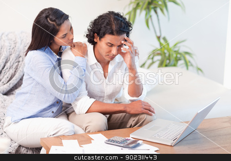 Frustrated couple underestimated their expenses stock photo, Frustrated young couple underestimated their expenses by Wavebreak Media