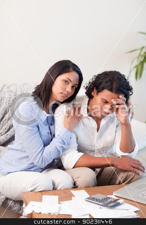 Couple frustrated by their expenses stock photo, Young couple frustrated by their expenses by Wavebreak Media