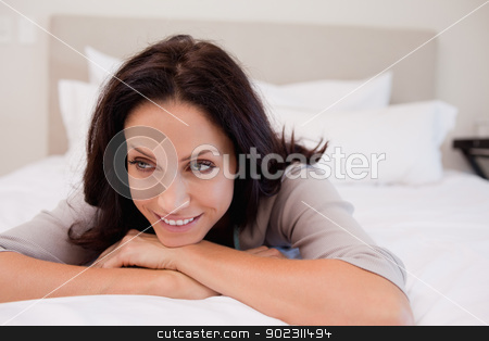 Woman in thoughts on the bed stock photo, Young woman in thoughts on the bed by Wavebreak Media