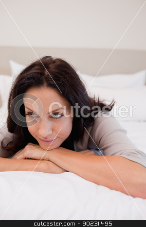 Thoughtful woman on the bed stock photo, Thoughtful young woman on the bed by Wavebreak Media