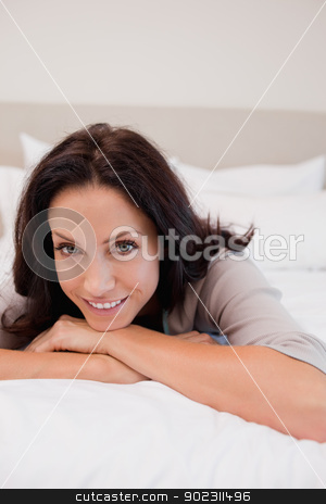 Smiling woman on the bed stock photo, Smiling young woman on the bed by Wavebreak Media