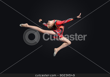 Young woman in gymnast suit posing stock photo, Young cute woman in gymnast suit show athletic skill on black background by Sergey Nivens