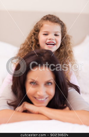 Girl sitting on her mothers back stock photo, Little girl sitting on her mothers back by Wavebreak Media