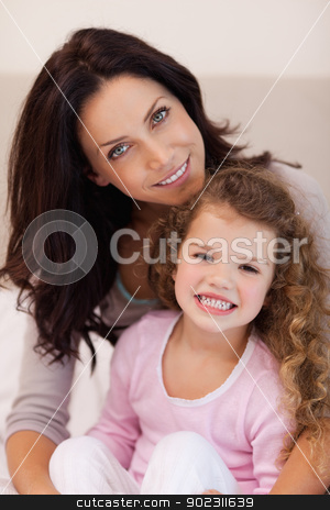 Mother embracing her daughter stock photo, Young mother embracing her daughter by Wavebreak Media